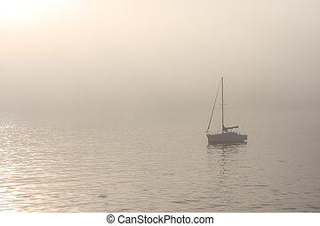 Sailboat on a foggy water