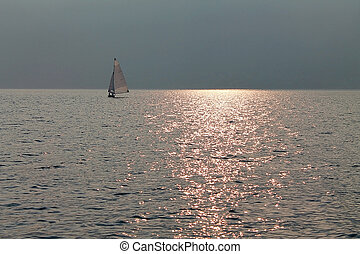 sailboat on a lake in the morning
