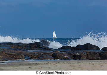 Sailboat on Atlantic Ocean - A catamaran sailboat sails past...