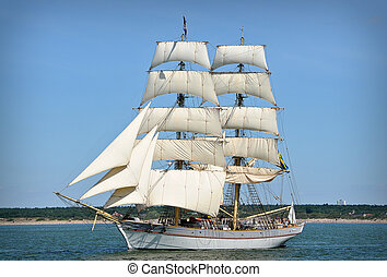 sailboat on full sails - sailboat going out of port with...