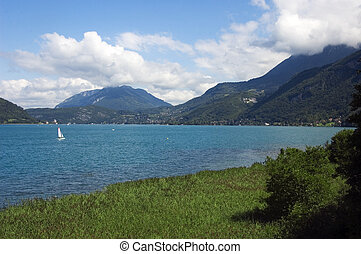 Sailboat on lake Annecy - View of a sailboat on lake Annecy...