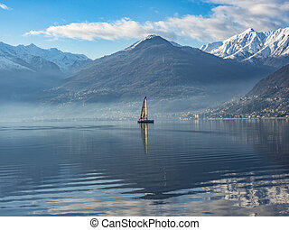 Sailboat on Lake Como at morning hours
