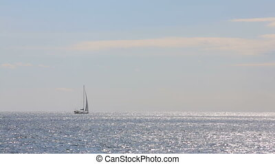 sailboat on the horizon in the sea