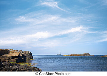 Sailboat on the sea under a blue sky