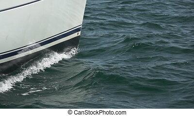 Sailboat prow sailing closeup in super slow motion