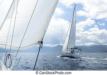 Sailboat race. Sailing on a calm sea. Luxury yachts.