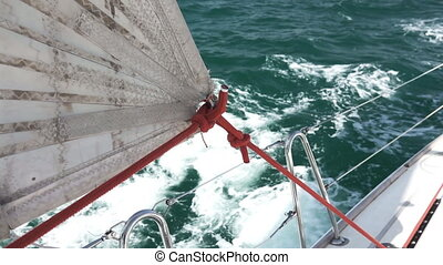 Sailboat sail close-up while sailing - Closeup view of...