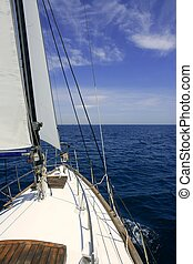 Sailboat sailing blue sea on sunny summer day in ...