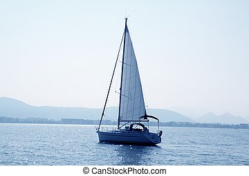 sailboat sailing in blue mediterranean sea