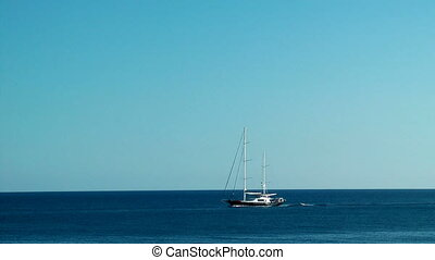 Sailboat sailing in the morning with blue sky. Rhodes. Greece.