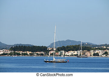 sailboat sailing near Corfu town Greece