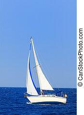 Sailboat sailing the ocean - Sailboat sailing in the morning...