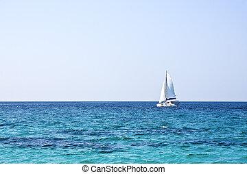 sailboat sky and ocean - sailboat on the horizon on a sunny...