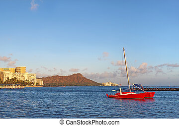 Sailboat, Waikiki beach and Diamond Head