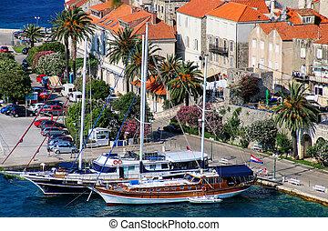Sailboats anchored at Korcula old town, Croatia