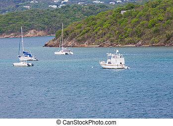 Sailboats and Cabin Cruiser Moored in Bay