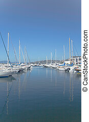 Sailboats and yachts in a quiet harbor ocean marina