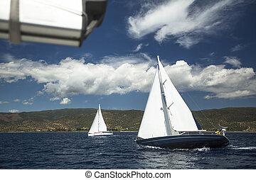 Sailboats at sailing regatta on Aegean Sea.