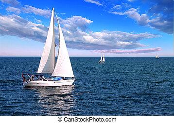 Sailboats at sea - Sailboat sailing in the morning with blue...