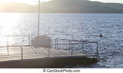 Sailboats in a quiet harbor on ocean