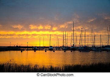 Sailboats in sunset