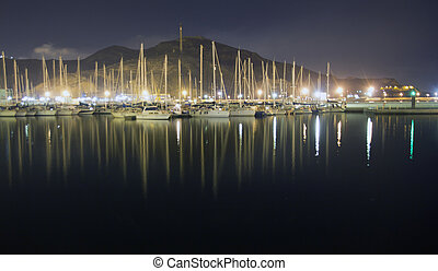sailboats in the harbor at night