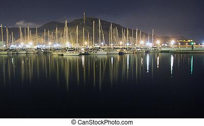 sailboats in the harbor at night