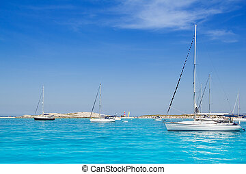 sailboats in turquoise beach of Formentera