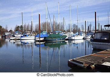 Sailboats moored in a marina, Portland OR.