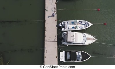 Sailboats moored in the port, a lot of beautiful yachts. Top view on Yachts and boats moored in the port