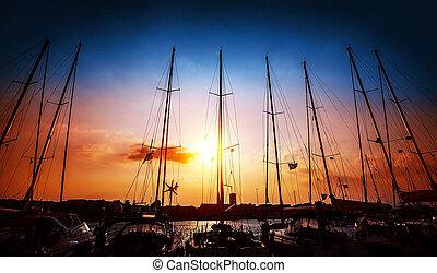 Sailboats on sunset