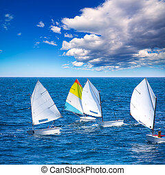 Sailboats Optimist learning to sail in Mediterranean at...