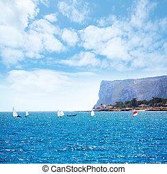 Sailboats Optimist learning to sail in Mediterranean at Denia