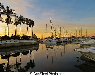 Sailbooats in a harbor in Bradenton, Florida at sunset