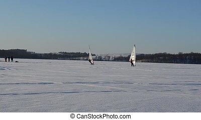 sailer winter ice surfer - follow two ice surfers men...