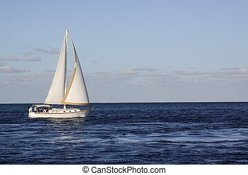 Sailing - A Sailboat on the ocean.