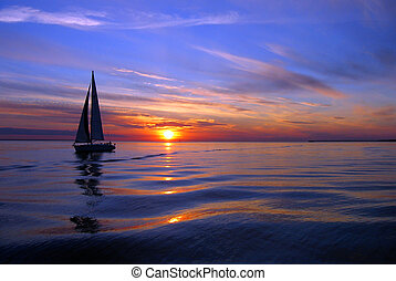 Sailing a Sea of Color. Silhouetted against the setting sun, was a little sailboat on Baltic Sea, Estonia, Europa. The sunset was beautiful on this night. Such an awesome light and that single sailing boat, it was wonderful!