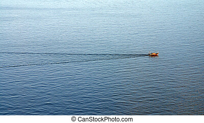 Sailing boat alone in the ocean