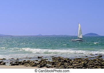 Sailing boat and shore