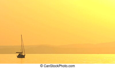 Sailing boat at dusk