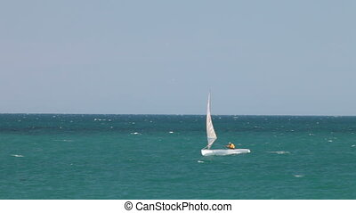 Sailing boat at  open sea