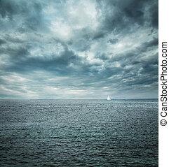 Sailing Boat at Stormy Sea. Dark Background.