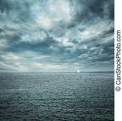 Sailing Boat at Stormy Sea. Dark Background. Loneliness...