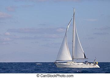 Sailing boat in  blue sea