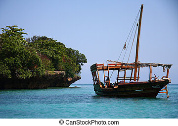 Sailing boat in blue water