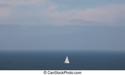 Sailing boat in open blue sea