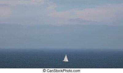 Sailing boat in open blue sea