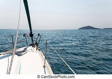Sailing boat in the open sea