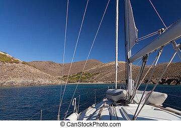 Sailing boat near greece island