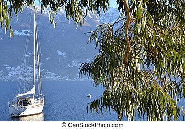 Sailing boat on a alpine lake